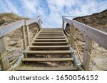 Wooden Stairs Leading Up A San...