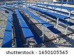 Blue sports bleachers at a softball and baseball ballpark