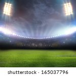stadium in lights and flashes | Shutterstock . vector #165037796