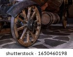 An Old Cart On Wooden Wheels...