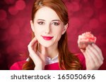 redhead girl with cake. photo... | Shutterstock . vector #165050696