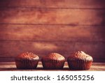 Muffin On Wooden Table. Photo...