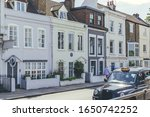 """Small photo of London/UK-1/08/18: Ninette de Valois's house at 14 The Terrace, Barnes, facing the river, with English Heritage blue plaque, """"Dame NINETTE DE VALOIS 1898–2001 Founder of the Royal Ballet lived here"""""""