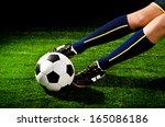 soccer player feet with ball... | Shutterstock . vector #165086186