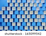 3d blue and white cubes in a... | Shutterstock . vector #165099542