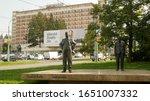 Small photo of ZLIN, CZECH REPUBLIC, MARCH 26, 2019: Tomas Bata and Jan Antonin Bata sculpture statue bronze public street in Zlin figure, footwear industry, shoe industrialist national economist Czech