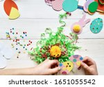 The Child Makes Crafts With Hi...