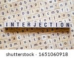 Small photo of Interjection word concept on cubes