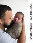newborn baby boy  being held by ... | Shutterstock . vector #1651068058