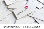Envelope with From Poland stamp among other envelopes. International mail related conceptual 3D rendering