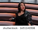 Small photo of Jazz Singer On Stage At Dress Rehearsal Or After Performance Under Spotlight.