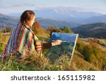 young artist painting an autumn ... | Shutterstock . vector #165115982