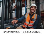 Young Forklift Driver Sitting...