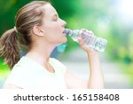 young beautiful woman drinking... | Shutterstock . vector #165158408