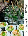 table with catering food   Shutterstock . vector #165170066