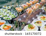 table with catering food | Shutterstock . vector #165170072