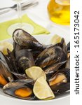 tasty plate of coocked mussels... | Shutterstock . vector #165173042