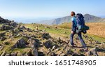 a hiker and their dog... | Shutterstock . vector #1651748905