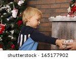 happy little boy holding gift... | Shutterstock . vector #165177902