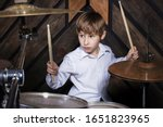 The Child Plays The Drums. Boy...