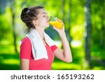 Young Woman Drinking Fresh...