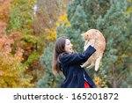 happy young woman holding her... | Shutterstock . vector #165201872