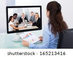 businesswoman sitting at a desk ...   Shutterstock . vector #165213416
