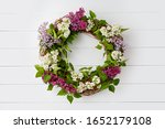 Wreath from purple lilac...