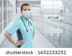 Small photo of Young shortcut caucasian woman doctor, wearing medical mask, copy space portrait