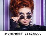 red haired girl with makeup... | Shutterstock . vector #165230096