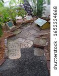 Small photo of Key West, Florida/USA - January 30, 2019: The cat cemetery on the property of Ernest Hemingway's house in Key West with the graves of his dead six-toed cats