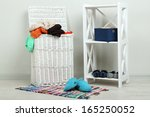 full laundry basket  on wooden... | Shutterstock . vector #165250052