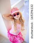 happy small fashion girl   Shutterstock . vector #165296132