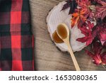Maple Syrup In Wooden Spoon To...