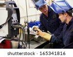 engineer teaching apprentice to ... | Shutterstock . vector #165341816