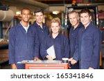 portrait of staff standing in... | Shutterstock . vector #165341846