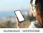 Woman Wearing Headphones...