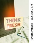 Small photo of Text sign showing Think Fresh. Conceptual photo Thinking on natural ingredients Positive good environment Note paper taped to black computer screen near keyboard and stationary.