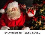 Santa Claus Decorating...