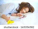 beautiful asian teen lay down... | Shutterstock . vector #165356582