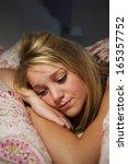teenage girl awake in bed... | Shutterstock . vector #165357752