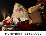 Santa Claus Sitting At Home An...