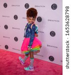 Small photo of Manhattan, New York City, Javits Center - April 6, 2019: Beautycon NYC 2019: little actress, model and YouTuber Red Lil Missy