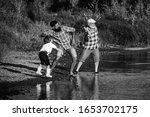 Male Child With Father And...