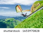 Hang Glider Pilots Runs From...