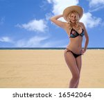 Hot blonde at the beach! - stock photo