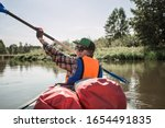 Young Woman With A Paddle. Bac...