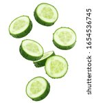 Falling cucumber slice isolated ...