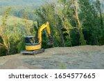 A Miniature Yellow Excavator...