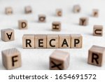 Small photo of RECAP - words from wooden blocks with letters, a summary of what has been said; a recapitulation RECAP concept, white background